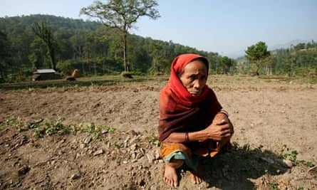 Nepal is highly vulnerable to natural disasters : A woman farmer on her land
