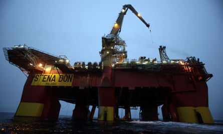 Cairn Energy's Stena Don oil rig is scaled by Greenpeace campaigners, Greenland