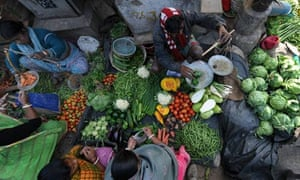 Indian vegetable vendors attend to clien