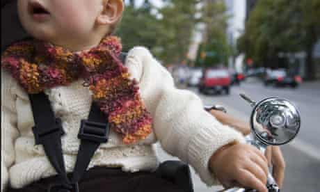 Bike blog : Close-up of a baby boy holding a cycle's handle