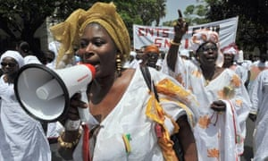 MDG : Feminism and development : Women march during a rally to mark May Day in Dakar