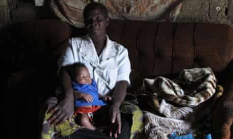 Adnes Zulu with her three week old grandson, Mukuka Chanda, Lusaka, Zambia