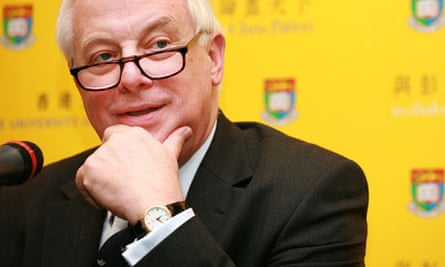 Hong Kong's former governor Chris Patten listens during the interview in Hong Kong