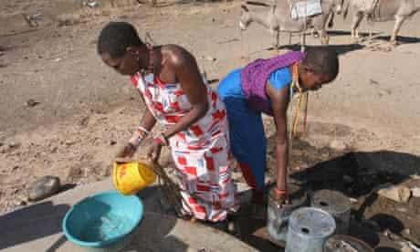 Maasai women collect water