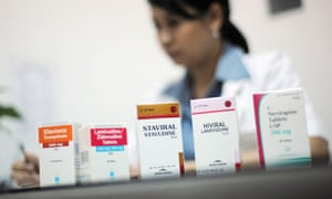MDG : HIV treatment : Boxes of antiretroviral medicines sit on the desk of Indonesian doctor