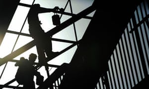 MDG : DFID and monitoring money donated : labourers work on a under construction bridge Islamabad