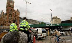 Cyclist outside Kings cross station London