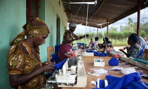 MDG : Millennium Villages project : Women are seen working in the knitting cooperative in Mayange