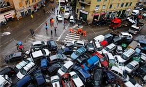 IPCC and extreme weather : Cars overturned torrential rains are seen on a street in Genoa, Italy