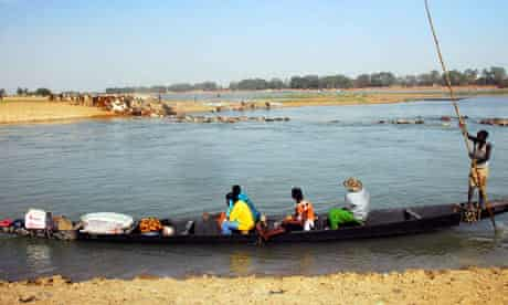 MDG :  Herder cross the Niger river with their , Mopti , Mali