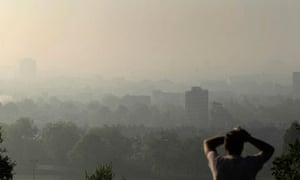 Air pollution in UK : smog covering central London from Parliament Hill