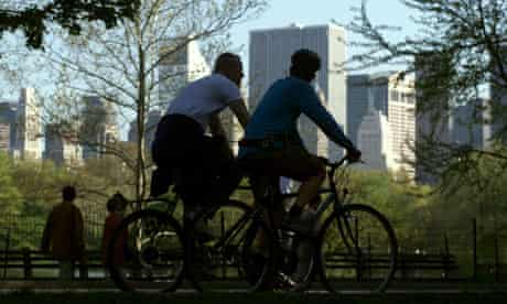 Cyclists ride through Central Park in New York