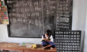MDG : India schools : Indian school girl writes on a slate