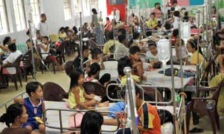 MDG : Young victims of dengue fever crowd the children's ward of Hospital in Manila
