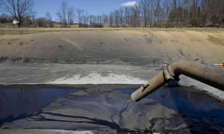 Shale Gas : A pipe leads to a lined pit used to collect drill cuttings, Pennsylvania