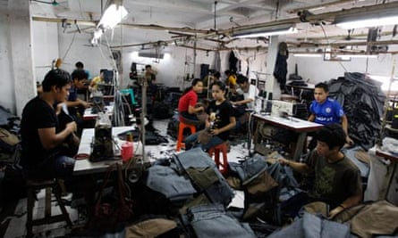 MDG : Sweatshop in Asia : Indonesian laborers work at a local garment factory in Jakarta, Indonesia