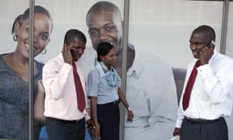 MDG : Botswana Diamond Industry : African businessmen on their mobile phones