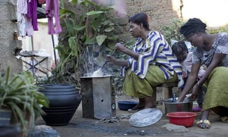 MDG : Food security in  Zambia, woman cooking on a stove