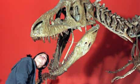Girl Looks into Mouth of Tarbosaurus at the Natural History museum, London