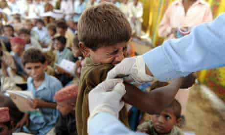MDG A Pakistani health worker gives a hepatitis vaccination, Pakistan