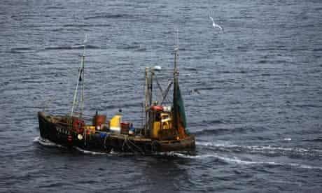 A Maria Damanaki on fisheries : fishing boat makes its way into Uig on the Isle of Skye