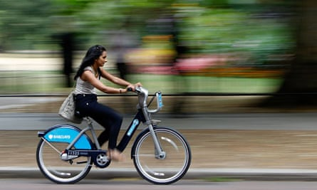 Bike blog :  A woman cycles past St James Park after the launch of London's cycle hire scheme