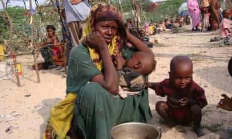 MDG : Drought in Somalia : A displaced Somali woman desperately awaits humanitarian assistant