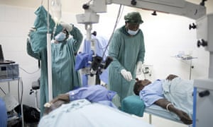 MDG : Getting out of poverty , Lusaka , Zambia : Doctors perform cataract surgery