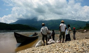 Myanmar workers standing on the bank of the Irrawady river, Kachin state