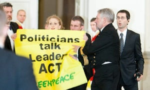 Activists from Greenpeace gatecrash the State Dinner for heads of state during COP15 in Copenhagen