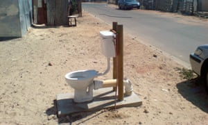 An open air toilets  installed by the City of Cape Town next to the road in Khayelitsha South Africa