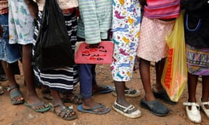 MDG : Zambia Child Abuse : Children stand in line outside St Anthony School in Kitwe