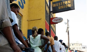 MDG : Haitians stand in line at a Western Union in Port-au-Prince, Haiti
