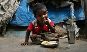MDG : Malnutrition in India : An Indian child eats mid-day meals, Hyderabad , Andhra Pradesh