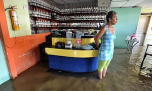 MDG : Colombia : A woman stands in a flooded disco in Juanchito, Colombia