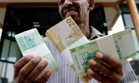 MDG : Cancelling debt : Sudan issues new currency