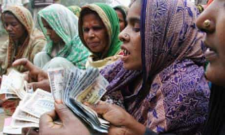 MDG : Microfinace : Bangladeshi Women Count Money or repayment to a microcredit bank