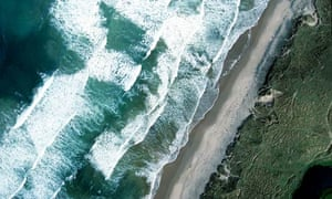 Wave and tidal energy : Aerial view of waves crashing along coastline