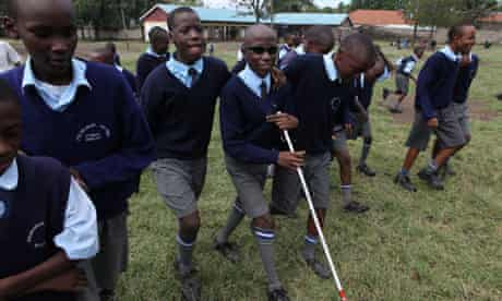 MDG :  Kenya : Blind 14 years old and is in class 8T at Menengai Primary School