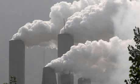 Smoke rises from a cement plant in Baokang