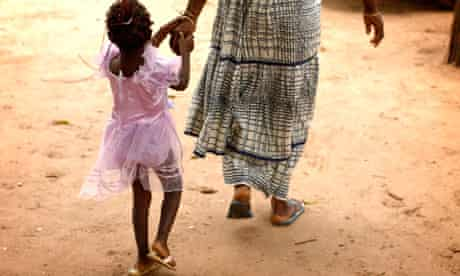 MDG : FGM : A mother and daughter after a meeting to eradicate female genital mutilation in Senegal