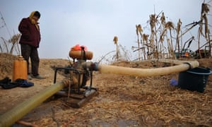 Water stress in China : A villager looks after a water pump to irrigate fields in Shandong