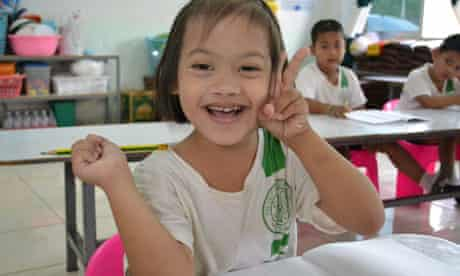 MDG : Thailand disability : Nuey, a six year old girl born with Downs Syndrome