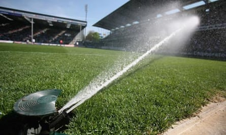 Leo blog :  A hose pipe jets water over soccer pitch