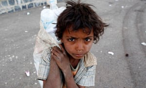 MDG : Poverty matter : A child collects empty bottles of water in Sanaa , Yemen