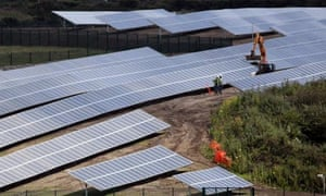 Caroline Spellman : Construction workers erect South West's First Solar Farm , UK