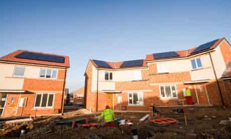 Green economy :  housing development with zero carbon houses with solar panels