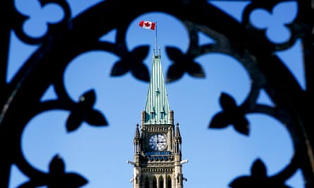 MDG : Canada ending bilateral aid : CIDA :  Canadian flag on Parliament Hill in Ottawa on