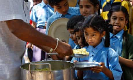 MDG : Jonathan Glennie  on Aid and poverty : A girl looks at food served to her for free