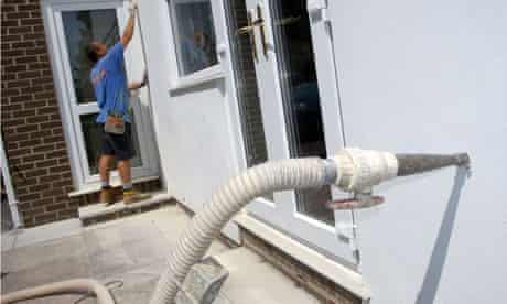 Green deal on insulation : Installing cavity wall insulation in modern house in Devon England